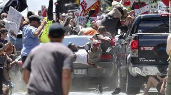 A car is driven through protesters in Charlotesville